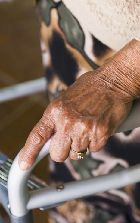 hand of elderly woman clutching a walker