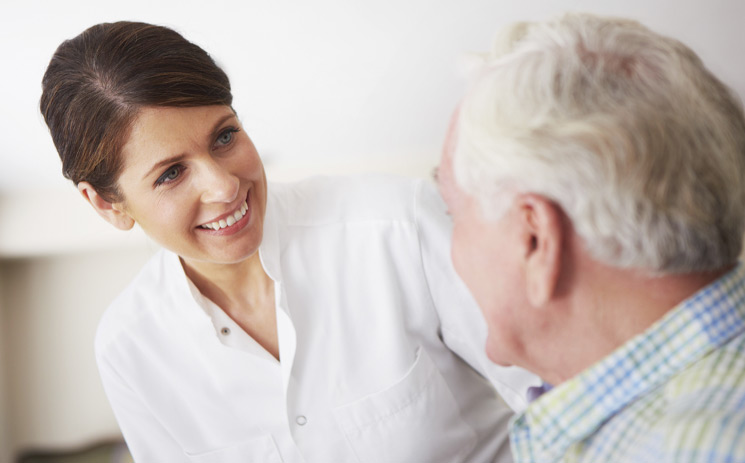 woman smiling and looking at elderly man